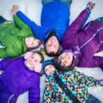 Portrait of a family stretched out in the snow pickle planet events moncton