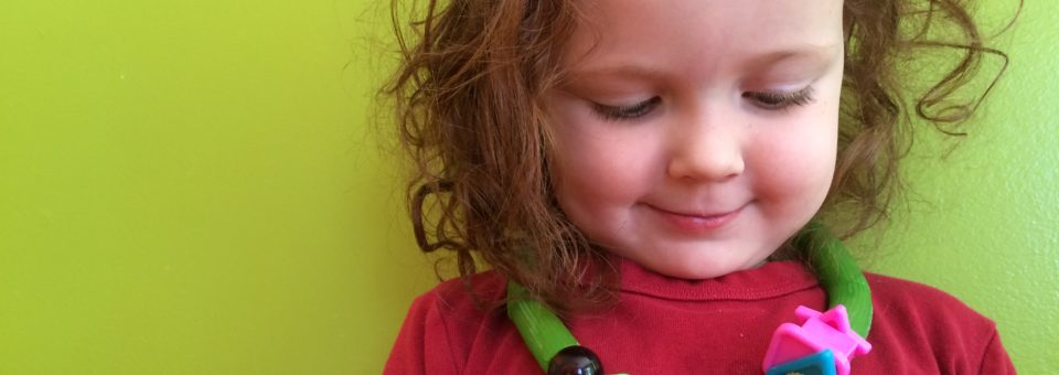green dyed pasta necklace fine motor skills