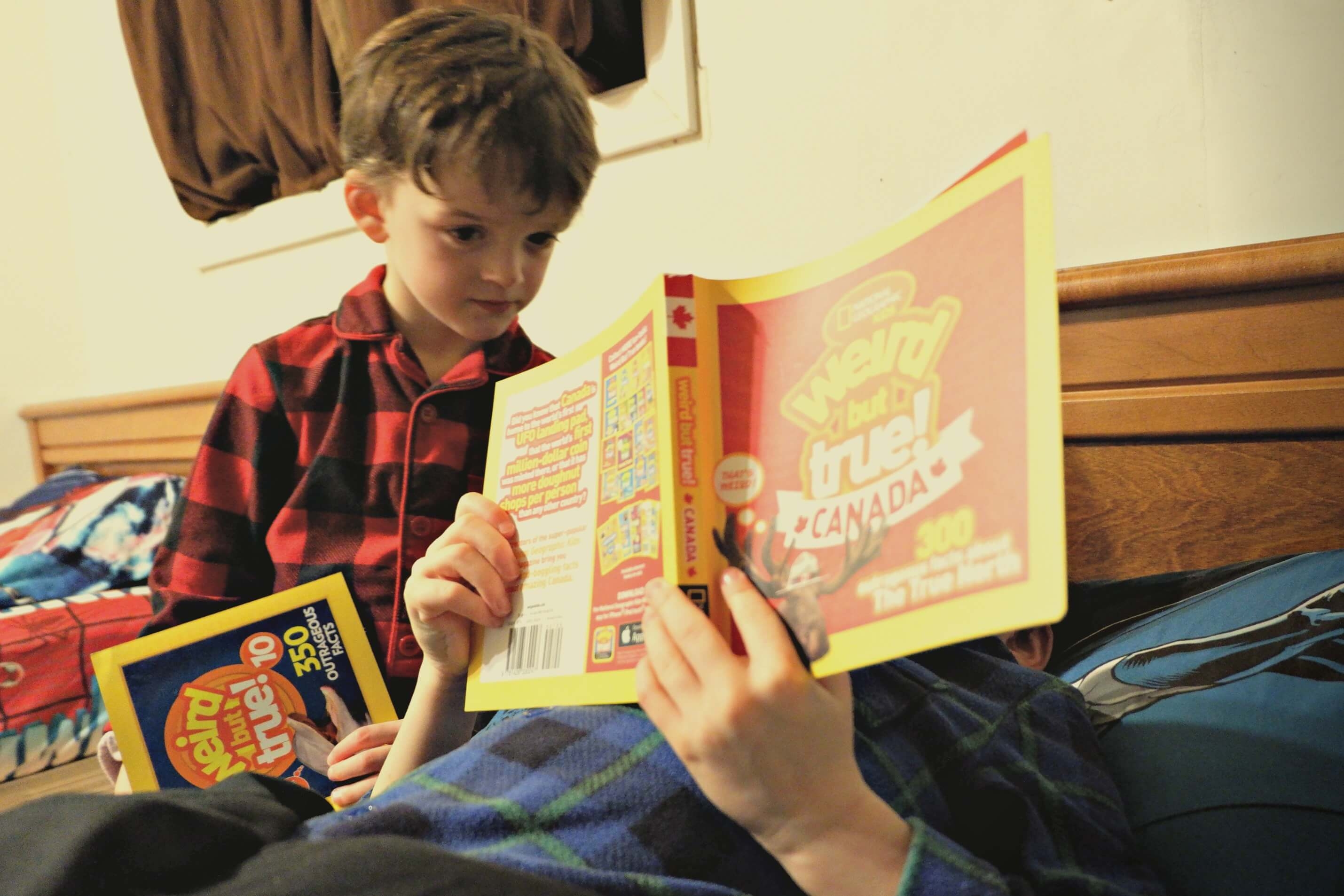 brothers reading together national geographic canada facts book weird but true bedtime reading brother kindergarten pickle planet