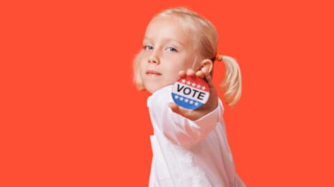 young girl holding voting button parents politics susan holt new brunswick leadership women
